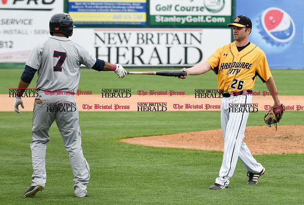 050317 Wesley Bunnell | Staff New Britain Bees vs Somerset Patriots in a Wednesday morning game attended by areas school children. Chris Hayes (26) hands the bat back to the Somerset batter after it flew out of his hands on the pitch.