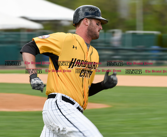 050317 Wesley Bunnell | Staff New Britain Bees vs Somerset Patriots in a Wednesday morning game attended by areas school children. Jon Griffin (33) runs down the first base line.