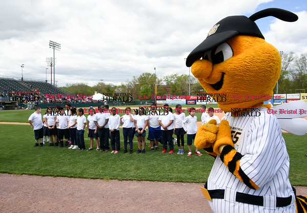 050317 Wesley Bunnell | Staff New Britain Bees vs Somerset Patriots in a Wednesday morning game attended by areas school children. Sting stands in front of children from the Fair Haven School in New Haven as they prepare to sing God Bless America.