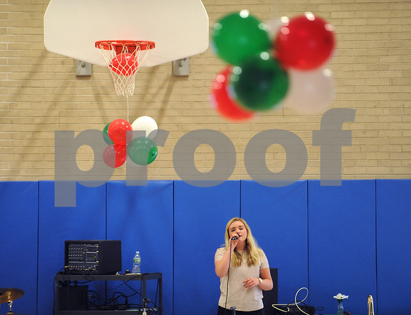 5/4/2017 Mike Orazzi | Staff Alexa Majka sings during the senior prom at the Bristol Senior Center Thursday.