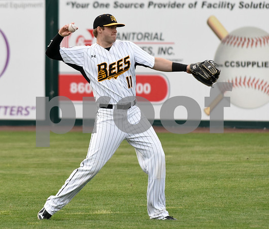 050417 Wesley Bunnell | Staff The New Britain Bees vs the Somerset Patriots on Thursday evening. Paul Kronenfeld (11) warms up before the game.
