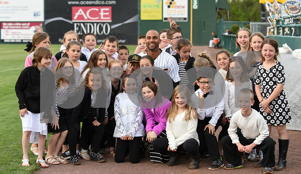 050417 Wesley Bunnell | Staff The New Britain Bees vs the Somerset Patriots on Thursday evening. Mike Crouse (10) poses with students from Jerome Harrison Elementary School in North Branford.