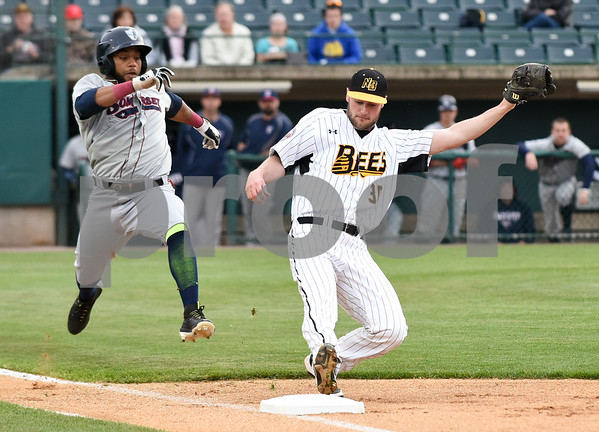 050417 Wesley Bunnell | Staff The New Britain Bees vs the Somerset Patriots on Thursday evening. Brian Dupra (30) covers first base on an infield ground ball beating the Somerset runner for the out.