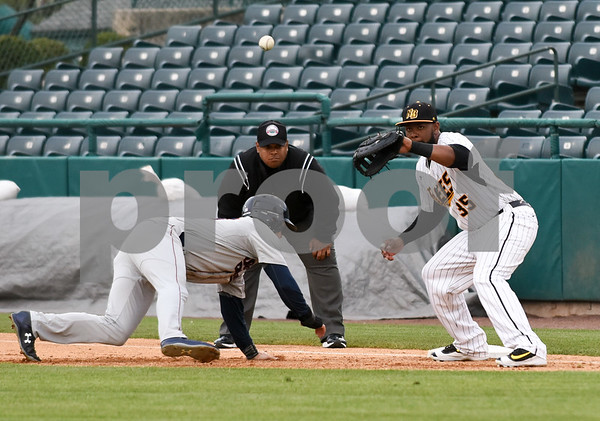 050417 Wesley Bunnell | Staff The New Britain Bees vs the Somerset Patriots on Thursday evening. Jovan Rosa (35) receives the throw from Brian Dupra (30) on a pick off attempt.