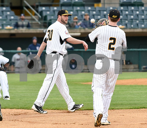 050417 Wesley Bunnell | Staff The New Britain Bees vs the Somerset Patriots on Thursday evening. Brian Dupra (30) tosses the ball to Jake McGuiggan (2) after covering first base for the out on an infield hit.
