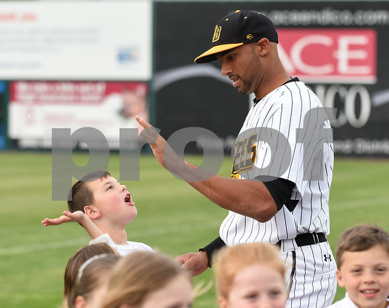 050417 Wesley Bunnell | Staff The New Britain Bees vs the Somerset Patriots on Thursday evening. Mike Crouse (10) high fives a student from Jerome Harrison Elementary School in North Branford after posing for a group photo.