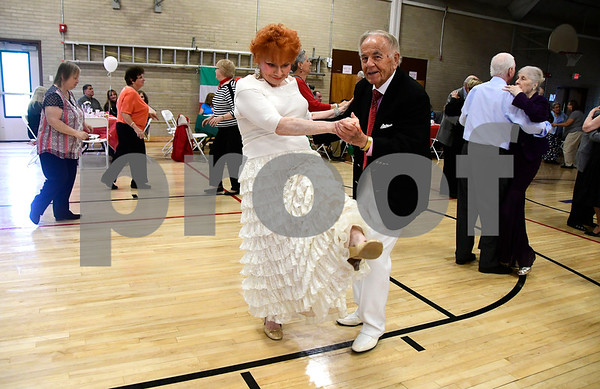 5/4/2017 Mike Orazzi | Staff Elsi Stempimski and Rob Snedicker during the senior prom at the Bristol Senior Center Thursday.