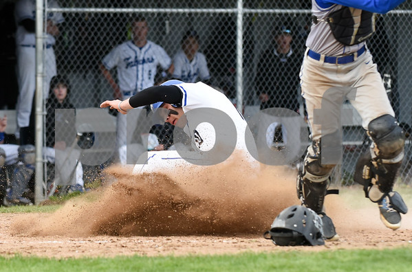 050817 Wesley Bunnell | Staff St. Paul Catholic baseball defeated Seymour on Monday afternoon 5-0. Andrew Owsianko (10) slides into home ahead of the tag.