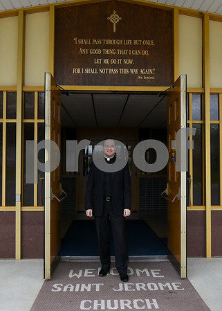 050817 Wesley Bunnell | Staff Rev. Andres Mendoza Floyd stands in front of St. Jerome Church which will be merging with St. Maurice.