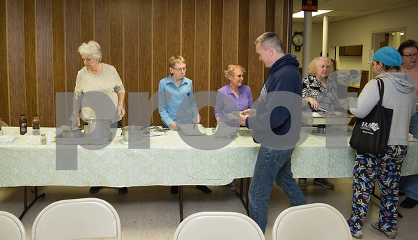 050917 Wesley Bunnell | Staff New Britain's homeless are invited to St. Peter's Church on Tuesday evening for a free meal served by volunteers. Volunteers serving are Jan Magiera, L, Jo Deccy, Denise Delaventura and Bettina Beauchemin.