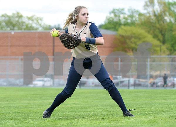051017 Wesley Bunnell | Staff Newington High School softball vs E.O. Smith on Wednesday afternoon. Left fielder Morgan Stegmaier (8).