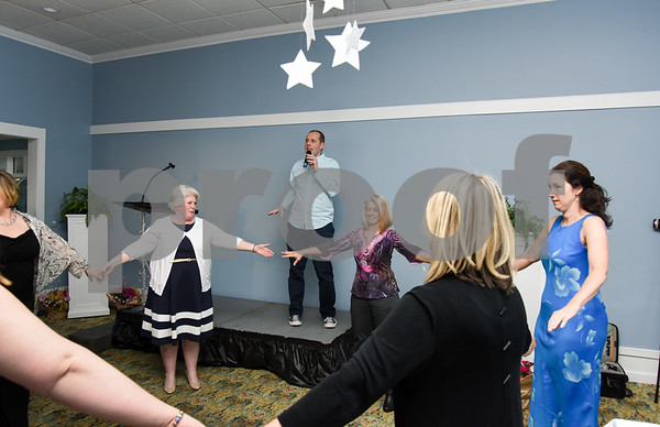 051017 Wesley Bunnell | Staff Bristol Hospital held their nursing award ceremony on Wednesday evening at the Chippanee Golf Club. Improv instructor Terry Withers , center, leads nurses in a team building exercise.