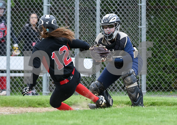 051017 Wesley Bunnell | Staff Newington High School softball vs E.O. Smith on Wednesday afternoon. Catcher Kinsey DelBuono (13).