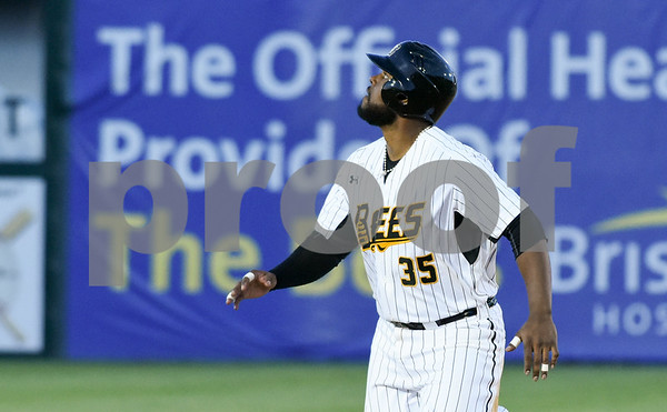 051117 Wesley Bunnell | Staff New Britain Bees won in a 9th inning walk off home run by Conor Bierfeldt (28) on Thursday evening 4-3 over the Long Island Ducks. Jovan Rosa (35) looks to left field as Beirfeldt's three run first home run of the night leaves the park.