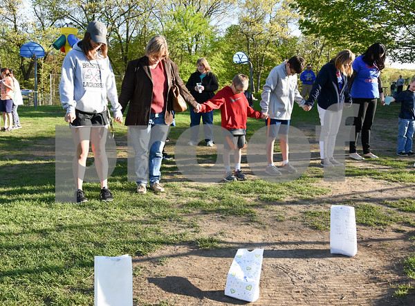 051117 Wesley Bunnell | Staff A Relay for Life was held on Thursday at South Side School to benefit 10 year old Connor Albert, aka Captain Connor, who was diagnosed with a form of bone cancer in April 2016. Participants bowed their heads and joined hands in a moment of silence.