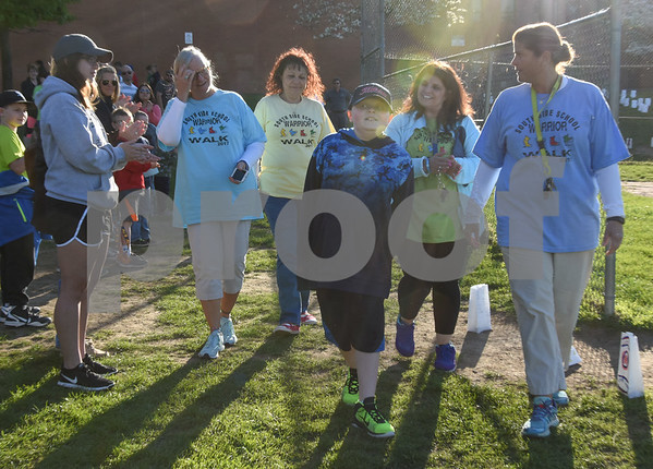 051117 Wesley Bunnell | Staff A Relay for Life was held on Thursday at South Side School to benefit 10 year old Connor Albert, aka Captain Connor, who was diagnosed with a form of bone cancer in April 2016. Librarian Pat Zadrozny, L, walks with Debbie Rivard, Connor, Josephine Marino & PE teacher Lisa Galske.