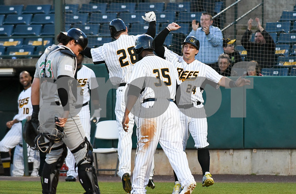 051117 Wesley Bunnell | Staff New Britain Bees won in a 9th inning walk off home run by Conor Bierfeldt (28) on Thursday evening 4-3 over the Long Island Ducks. Conor Bierfeldt (28) gets congratulated by teammates including Craig Maddox (24) after driving him in with a three home run in the fourth inning.