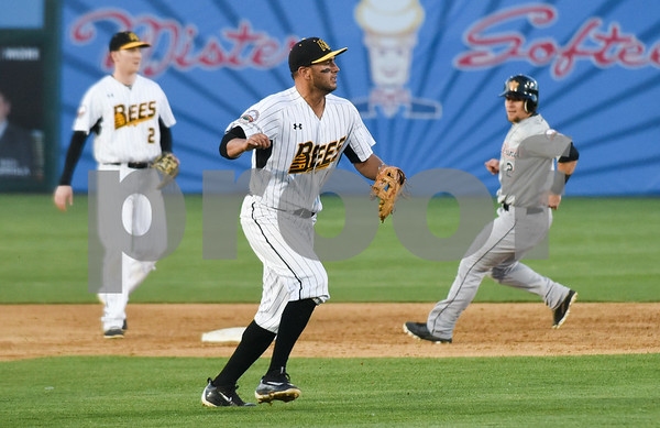 051117 Wesley Bunnell | Staff New Britain Bees won in a 9th inning walk off home run by Conor Bierfeldt (28) on Thursday evening 4-3 over the Long Island Ducks. Steve Carillo (4) after a throw on the run to first base for the out.