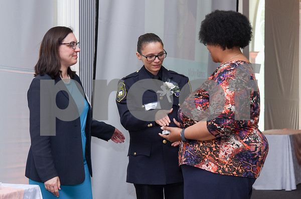 051117 Wesley Bunnell | Staff Lt. Jeanette Portalin of the New Britain Police Department receives congratulations during the New Britain YWCA's 17th Biennial Women in Leadership Luncheon at the Aqua Turf on Thursday afternoon.