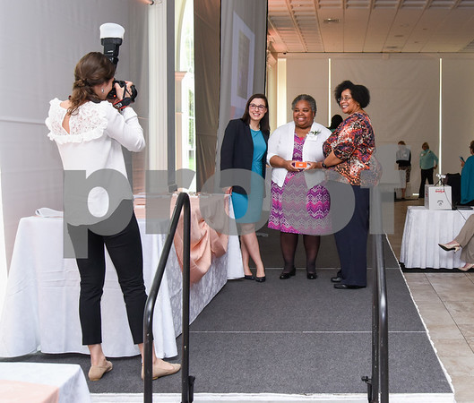 051117 Wesley Bunnell | Staff Board Chair of Klinbgerg Family Centers Natalie Lynne Smith, center, poses for a photograph after being announced during the New Britain YWCA's 17th Biennial Women in Leadership Luncheon at the Aqua Turf on Thursday afternoon.