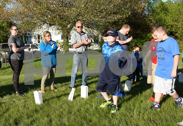 051117 Wesley Bunnell | Staff A Relay for Life was held on Thursday at South Side School to benefit 10 year old Connor Albert, aka Captain Connor, who was diagnosed with a form of bone cancer in April 2016. Conor, center, walks the course with friends and classmates.