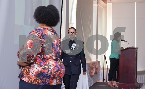 051117 Wesley Bunnell | Staff Lt. Jeanette Portalin of the New Britain Police Department walks across the stage after being introduced during the New Britain YWCA's 17th Biennial Women in Leadership Luncheon at the Aqua Turf on Thursday afternoon.