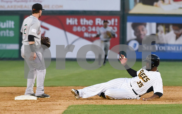051117 Wesley Bunnell | Staff New Britain Bees won in a 9th inning walk off home run by Conor Bierfeldt (28) on Thursday evening 4-3 over the Long Island Ducks. Jovan Rosa (35) slides safely into second base.