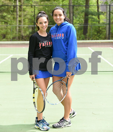 051517 Wesley Bunnell | Staff St. Paul High School girls tennis defeated Holy Cross in a quarter final NVL match on Monday afternoon. Victoria Kilbourne, L, stands with Natasha Kempes.