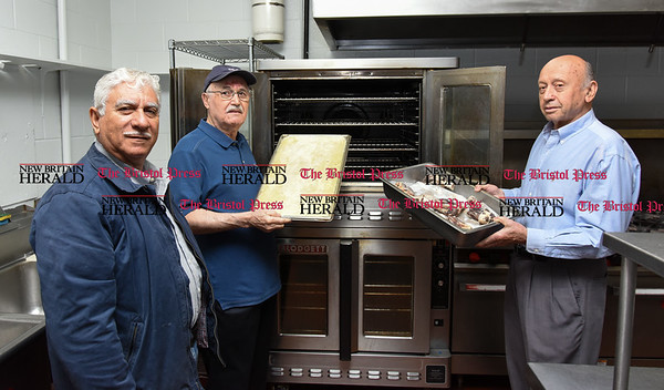 052217 Wesley Bunnell | Staff Food preparation is underway for St. George Greek Orthodox Churchs 34th annual Dionysos Festival. President Michael T. Michae, L, Chef James Soukas, & Asst. Chef John Georgopoulus.