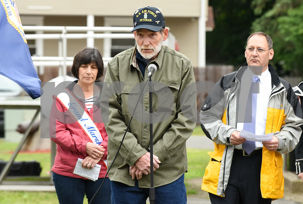 052917 Wesley Bunnell | Staff Plainville held their annual Memorial Day Parade on Monday morning followed by a memorial unveiling dedicated to Gold Star Families at Veterans Memorial Park. Air Force veteran Bob Doolittle who came up with the idea for the monument addresses the crowd.
