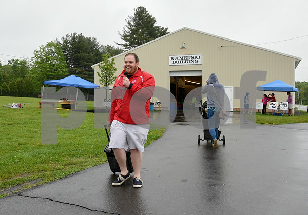 052517 Wesley Bunnell | Staff The Berlin High School Upbeat Club held their annual picnic at the Berlin Fair Grounds on a soggy Thursday May 25. Upbeat Director Jack Rudy made the rounds with a portable loud speaker announcing the evenings activities.
