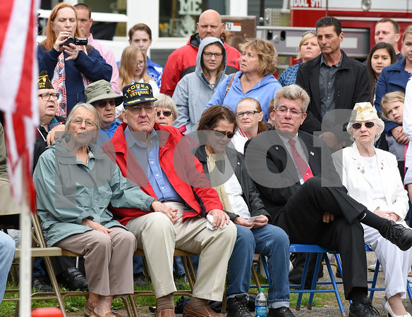 052917 Wesley Bunnell | Staff Plainville held their annual Memorial Day Parade on Monday morning followed by a memorial unveiling dedicated to Gold Star Families at Veterans Memorial Park. Several of those in attendance became emotion during there unveiling. Robert Lee Woods, 2nd from L, sits with his wife, L, and daughter Laura Woods on the right.
