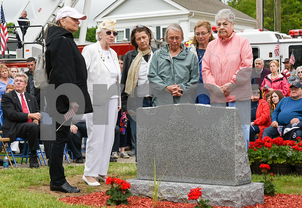 052917 Wesley Bunnell | Staff Plainville held their annual Memorial Day Parade on Monday morning followed by a memorial unveiling dedicated to Gold Star Families at Veterans Memorial Park. Gold Star families, families who have lost loved ones in service to their country, stand around the new monument. President of the Gold Star Mothers Inc. of CT Mary Kight is second from the left.
