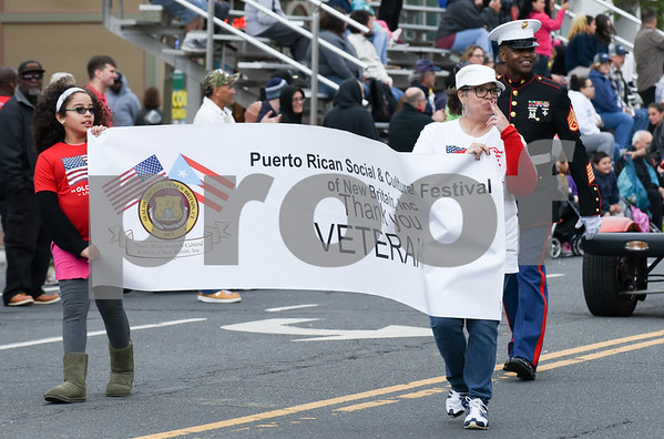 053017 Wesley Bunnell | Staff The City of New Britain held their annual Memorial Day Parade on Tuesday evening. Members of the Puerto Rican Social & Cultural Festival of New Britain members pass the grandstand.