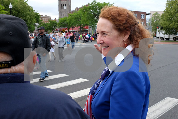 053017 Wesley Bunnell | Staff The City of New Britain held their annual Memorial Day Parade on Tuesday evening. Congresswoman Elizabeth Esty waves to marchers at the intersection of Main & South Main St.