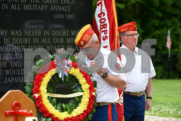 053017 Wesley Bunnell | Staff Members from the Marine Corps League Hardware City Detachment were on hand to hold a Memorial Day ceremony at the Iwo Jima Memorial in Newington. The detachment's Fred McGoldrick presents a wreath at the memorial.