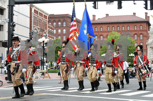 053017 Wesley Bunnell | Staff The City of New Britain held their annual Memorial Day Parade on Tuesday evening. Marchers in front of Central Park.