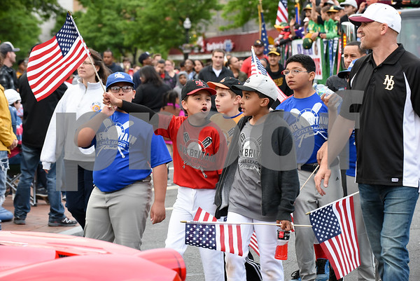 053017 Wesley Bunnell | Staff The City of New Britain held their annual Memorial Day Parade on Tuesday evening. Marchers from Fagan Baseball League.