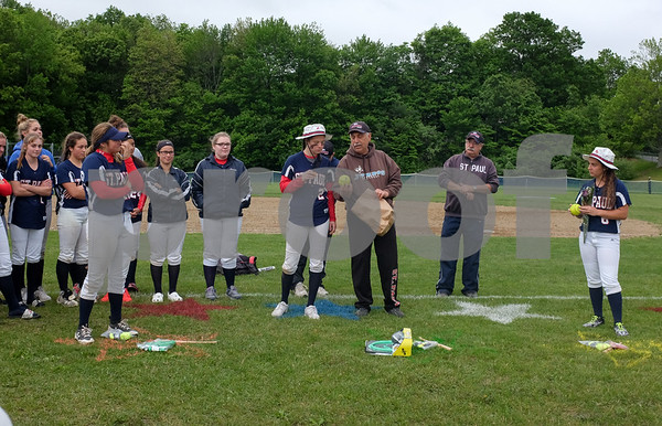 053017 Wesley Bunnell | Staff St. Paul softball defeated St. Barnard on Tuesday afternoon. Brigid Johndrow (2) stands with coach Gary Hovhanessian as all seniors were presented with gifts at the end of the game.