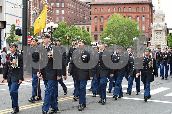 053017 Wesley Bunnell | Staff The City of New Britain held their annual Memorial Day Parade on Tuesday evening. JROTC students from New Britain High School pass Central Park.