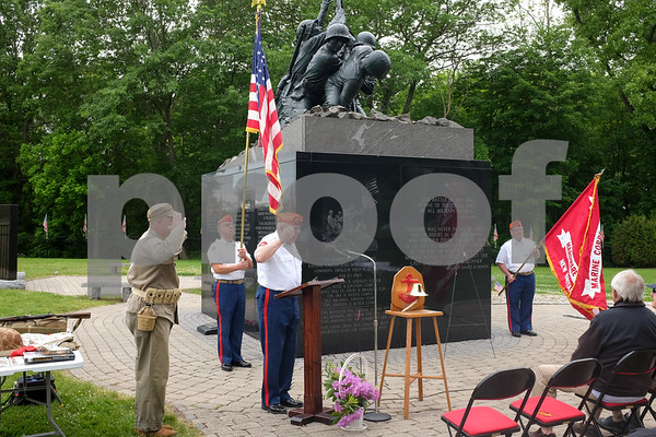 053017 Wesley Bunnell | Staff Members from the Marine Corps League Hardware City Detachment were on hand to hold a Memorial Day ceremony at the Iwo Jima Memorial in Newington. President of the memorial park Mark A. Adamski, L, salutes with members of the detachment including John J. Lynch at the podium.