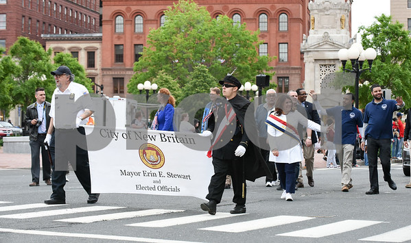 053017 Wesley Bunnell | Staff The City of New Britain held their annual Memorial Day Parade on Tuesday evening. Mayor Erin Stewart marches with other elected officials past Central Park.