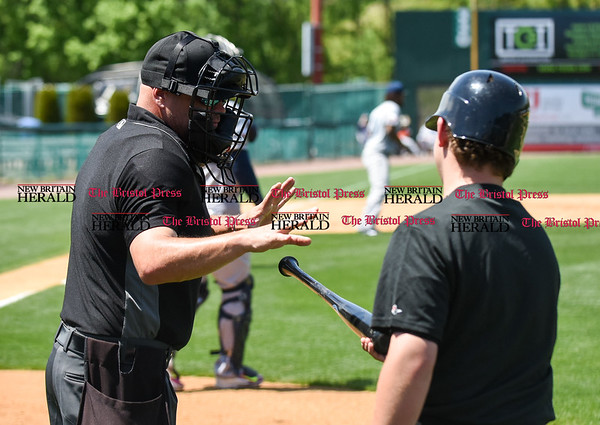 051617 Wesley Bunnell | Staff The New Britain Bees vs the Bridgeport Bluefish in the 2nd game of a double header played early afternoon on Tuesday. The umpire hands a broken bat from Jake McGuiggan (2) to the ball boy.