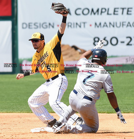 051617 Wesley Bunnell | Staff The New Britain Bees vs the Bridgeport Bluefish in the 2nd game of a double header played early afternoon on Tuesday. Michael Baca (5) fields the throw to second but the runner was called safe.