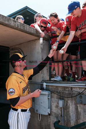 051617 Wesley Bunnell | Staff The New Britain Bees vs the Bridgeport Bluefish in the 2nd game of a double header played early afternoon on Tuesday. Jon Griffin (33) signs autographs before the start of the game.