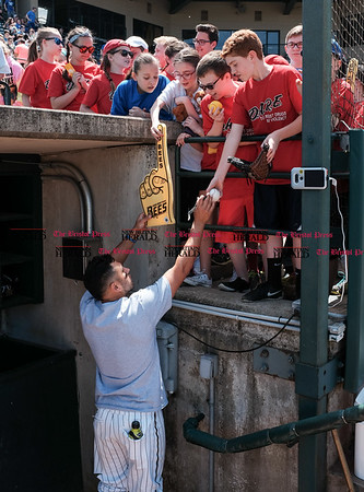 051617 Wesley Bunnell   Staff The New Britain Bees vs the Bridgeport Bluefish in the 2nd game of a double header played early afternoon on Tuesday. Steve Carillo (4) signs autographs for fans before the start of the game.