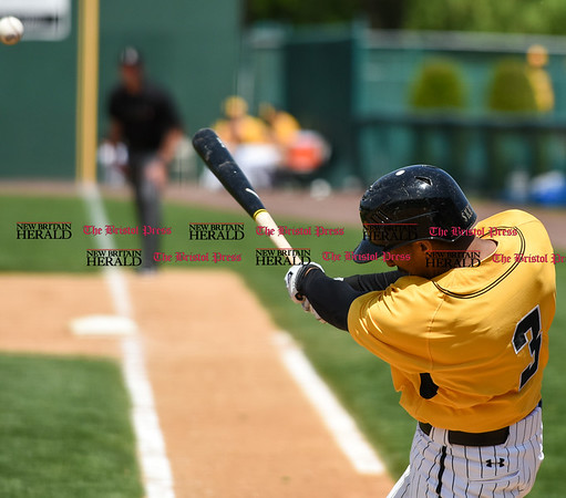 051617 Wesley Bunnell | Staff The New Britain Bees vs the Bridgeport Bluefish in the 2nd game of a double header played early afternoon on Tuesday. The ball flies out of the frame after being hit by James Skelton (3)