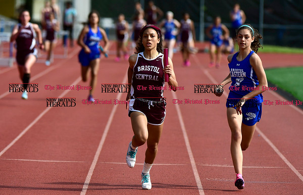 5/16/2017 Mike Orazzi | Staff Bristol Central's Nicole Pizarro and Bristol Eastern's Kailey Laprise during Tuesday's track meet at Eastern.