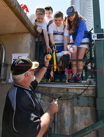 051617 Wesley Bunnell | Staff The New Britain Bees vs the Bridgeport Bluefish in the 2nd game of a double header played early afternoon on Tuesday. Manager Stan Cliburn (16) signs autographs for fans before the start of the game.