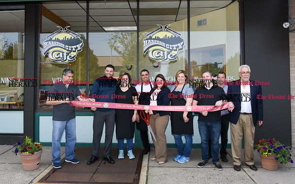 051617 Wesley Bunnell | Staff The Hardware City Cafe held its ribbon cutting on Tuesday afternoon with Mayor Erin Stewart and city officials. Alderman Carmelo Rodriguez Jr., L, Alderman Kristian Rosado, co-owner Miriam Geraci, co-owner Isaac Silva, Mayor Erin Stewart, co-owner Ellen Cedarfield, Alderman Robert Smedley & Alderman Daniel Salerno far right. Miriam Geraci, L, stands with Ellen Cedarfield along with Isaac Silva.